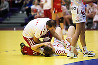 22 MAR 2012 - LOUGHBOROUGH, GBR - Polish physio Grzegorz Wowra treats Alina Wojtas (POL) during the women's 2012 European Handball Championships qualification match against Great Britain at Loughborough University in Loughborough, Great Britain .(PHOTO (C) 2012 NIGEL FARROW)
