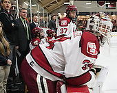 Albie O'Connell (Harvard - Assistant Coach), Ted Donato (Harvard - Head Coach), Rob Rassey (Harvard - Assistant Coach), [h24[, Desmond Bergin (Harvard - 37) - The Harvard University Crimson defeated the Princeton University Tigers 3-2 on Friday, January 31, 2014, at the Bright-Landry Hockey Center in Cambridge, Massachusetts.