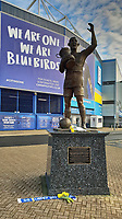 Pictured: Flowers and a tribute left by the statue of Fred Keenor outside the Cardiff City Stadium in south Wales, UK. Tuesday 22 January 2019<br /> Re: Premier League footballer Emiliano Sala was on a flight which disappeared between France and Cardiff.<br /> The Argentine striker was one of two people on board the Piper Malibu, which disappeared off Alderney on Monday night.<br /> Cardiff City FC, signed the 28-year-old from French club Nantes.<br /> A search is under way.<br /> A Cardiff Airport spokeswoman confirmed the aircraft was due to arrive from Nantes but said there were no further details.<br /> HM Coastguard has sent two helicopters to help.