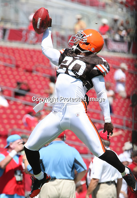 Cleveland Browns defensive back Mike Adams catches a pass during pre-game warm-ups as the Browns played the Buccaneers in the opening NFL regular season game Sunday, Sept. 12, 2010 in Tampa,Fla. (AP Photo/Margaret Bowles)