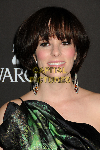 PARKER POSEY .Attending the 12th Annual Costume Designers Guild Awards held at the Beverly Hilton Hotel.  .Beverly Hills, California, USA,  .25th February 2010 .arrivals portrait headshot fringe dangly earrings green smiling one shoulder .CAP/ADM/BP.©Byron Purvis/AdMedia/Capital Pictures.
