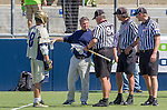 Costa Mesa, CA 03/08/14 - Notre Dame Coach Kevin Corrigan speaks with the referees before the start of their game against Denver as Eddy Lubowicki (Notre Dame #18) looks on.