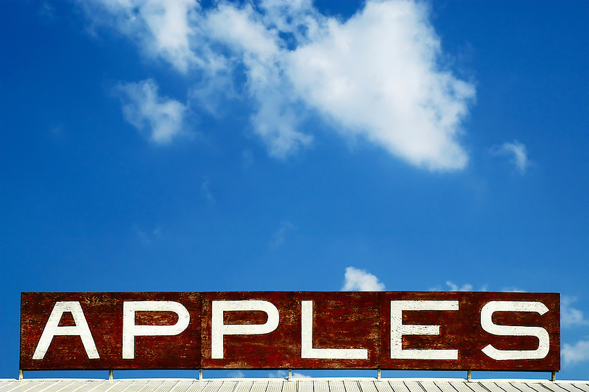 Photo of a sign on top of building housing a fruit stand in Ontario, Canada. Photograph by Robert Wade.