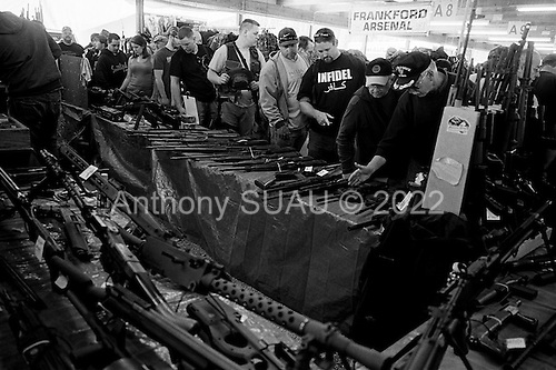 Machine Gun Shoot<br /> Knob Creek<br /> Westpoint, Kentucky<br /> April 4, 2009<br /> <br /> Nearly 16,000 people attend the Knob Creek Machine Gun Shoot &amp; Military Gun Show. It is the largest gathering of Civilian owned machine guns in the world. The gun show has over 700 tables with machine guns, military surplus, ammo, hard to find parts &amp; pieces and regular firearms and supplies.<br /> <br /> Firearms sales have surged in the six months since Obama's election as millions of Americans have gone on a buying spree that has stripped gun shops in some parts of the country almost bare of ammunition.