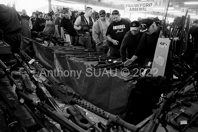 Machine Gun Shoot<br /> Knob Creek<br /> Westpoint, Kentucky<br /> April 4, 2009<br /> <br /> Nearly 16,000 people attend the Knob Creek Machine Gun Shoot & Military Gun Show. It is the largest gathering of Civilian owned machine guns in the world. The gun show has over 700 tables with machine guns, military surplus, ammo, hard to find parts & pieces and regular firearms and supplies.<br /> <br /> Firearms sales have surged in the six months since Obama's election as millions of Americans have gone on a buying spree that has stripped gun shops in some parts of the country almost bare of ammunition.