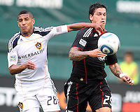 Santino Quaranta #25 of D.C. United clashes with Sean Franklin #28 of the Los Angeles Galaxy during an MLS match at RFK Stadium on July 18 2010, in Washington D.C. Galaxy won 2-1.