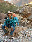 Hualapai Guide Dwayne Parker rests in the shade of Clay Tank Canyon, Grand Canyon National Park.