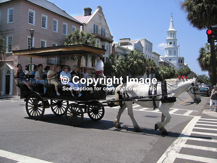 Popular with visitors are carriage rides. Many of the guides are very entertaining and informative. Taken in Charleston, South Carolina, USA. 200705140051...Copyright Image from Victor Patterson, 54 Dorchester Park, Belfast, UK, BT9 6RJ..Tel: +44 28 9066 1296.Mob: +44 7802 353836.Voicemail +44 20 8816 7153.Skype: victorpattersonbelfast.Email: victorpatterson@mac.com.Email: victorpatterson@ireland.com (back-up)..IMPORTANT: If you wish to use this image or any other of my images please go to www.victorpatterson.com and click on the Terms & Conditions. Then contact me by email or phone with the reference number(s) of the image(s) concerned.