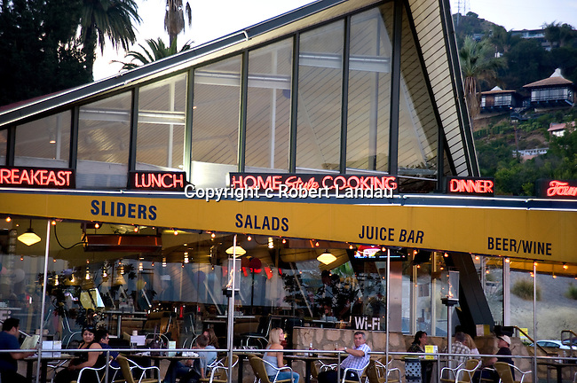 People dining on outdoor patio at Mel's restaurant on the Sunset Strip in Los Angeles, CA