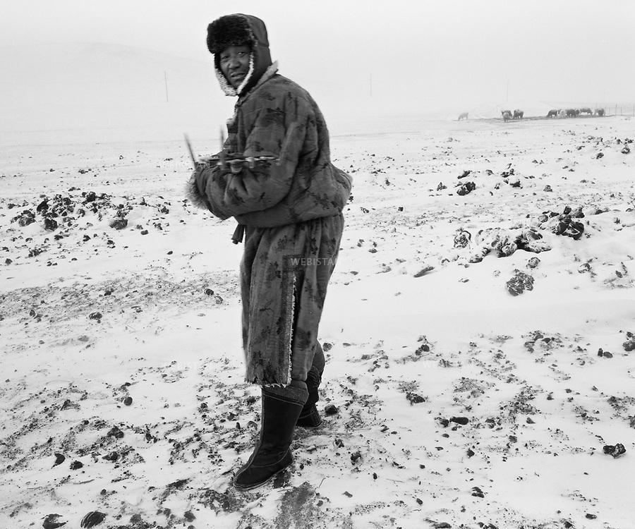 Inner Mongolia. 2007:  The herdsman in the snow disaster <br /> <br /> Mongolie interieure. 2007: Gardien de troupeaux dans le paysage enneige