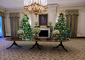 "The 2018 White House Christmas decorations, with the theme ""American Treasures"" which were personally selected by first lady Melania Trump, are previewed for the press in Washington, DC on Monday, November 26, 2018. Christmas trees decorate the State Dining Room around the portrait of US President Abraham Lincoln.  <br /> Credit: Ron Sachs / CNP"