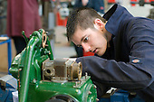 Working on a Petter PU8 stationary engine.  Apprentice engineering students at Kingston College..