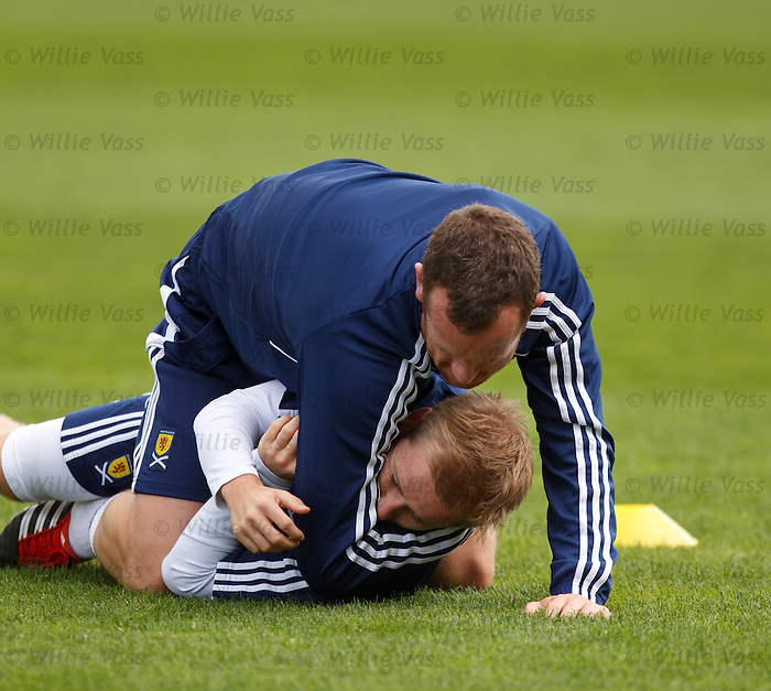 Charlie Adam trying to rip Barry Bannan's head off at training after the pair had a joust on Twitter