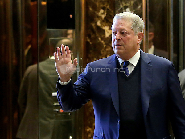 Former United States Vice President Al Gore waves as he exits the elevators at Trump Tower on December 5, 2016 in New York City. U.S. President-elect Donald Trump is still holding meetings upstairs at Trump Tower as he continues to fill in key positions in his new administration. <br /> Credit:John Angelillo / Pool via CNP /MediaPunch