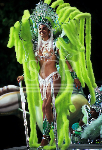 Rio de Janeiro, Brazil. Carnival samba dancer wearing green feather costume and skimpy green and white beaded bikini.