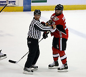 February 22nd 2008:  Jeremy Yablonski (33) of the Binghamton Senators is restrained by linesman Michael Baker (11) during a game vs. the Rochester Amerks at Blue Cross Arena at the War Memorial in Rochester, NY.  The Senators defeated the Amerks 4-0.   Photo copyright Mike Janes Photography