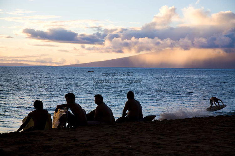 Skimboarders on the beach at Kaanapali, Maui, HI, US