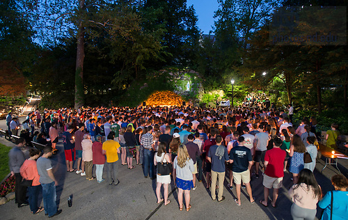 May 18, 2017; Seniors gather in front of the Grotto for their last visit before 2017 Commencement. (Photo by Barbara Johnston/University of Notre Dame)