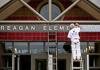 NWA Democrat-Gazette/JASON IVESTER <br /> Mike Johnson with Laxen Painting paints the entryway on Tuesday, Aug. 4, 2015, at Reagan Elementary School in Rogers. In addition to the new paint, the school also got a new roof over the center portion of the school and new flooring in the office area. Students return to classes on Aug. 17.