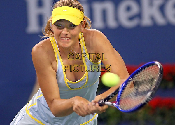 MARIA SHARPOVA.Plays Nadia Petrova at The US Open Tennis Tournament held at Flushing Meadows, Sharapova won 7-5,4-6, 6-4..New York, 7th September 2005.half length court competition white yellow racket ball sport.www.capitalpictures.com.sales@capitalpictures.com.© Capital Pictures.