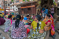 Nepal, Kathmandu. Durbar Square, damaged during the earthquake. Group of women sewing.