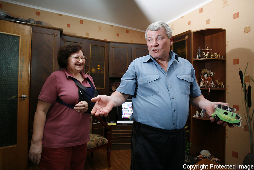 Nadya and Anatoly Shevchenko welcome guests to their home in Slavutych in 2009.<br /> <br /> As this book went to press, Anatoly learned he had terminal cancer.<br /> ------------------- <br /> This photograph is part the book of Would You Stay?, by Michael Forster Rothbart, published by TED Books in 2013. The photos come from Forster Rothbart&rsquo;s two long-term documentary photography projects, After Chernobyl and After Fukushima.<br /> &copy; Michael Forster Rothbart 2007-2013.<br /> www.afterchernobyl.com<br /> www.mfrphoto.com &bull; 607-267-4893 &bull; 607-436-2856 <br /> 34 Spruce St, Oneonta, NY 13820<br /> 86 Three Mile Pond Rd, Vassalboro, ME 04989<br /> info@mfrphoto.com<br /> Photo by: Michael Forster Rothbart