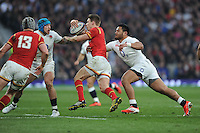 Manu Tuilagi of England tackles Liam Williams of Wales as Jack Nowell of England supports during the RBS 6 Nations match between England and Wales at Twickenham Stadium on Saturday 12th March 2016 (Photo: Rob Munro/Stewart Communications)