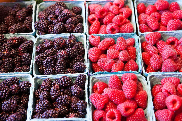 Blackberries and Raspberries in the Pike Market in Seattle , WA.