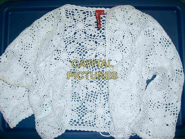 SALLY ANN BOWMAN'S CARDIGAN.Aspiring model, Sally Ann Bowman's body was found in Blenheim Crescent, Croydon, London in September 2005. Mark Dixie was sentenced to life in prison and will serve a minimum of 34 years for her Sally Ann's murder..white crochet knitted .CAP/DH.©David Hitchens/Capital Pictures