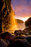 ephemeral waterfalls near Queen's Bath at sunset, Kauai, Hawaii, USA, Pacific Ocean