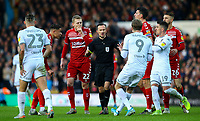 Referee Keith Stroud is surrounded by players after a foul by Leeds United's Kalvin Phillips<br /> <br /> Photographer Alex Dodd/CameraSport<br /> <br /> The EFL Sky Bet Championship - Leeds United v Middlesbrough - Saturday 30th November 2019 - Elland Road - Leeds<br /> <br /> World Copyright © 2019 CameraSport. All rights reserved. 43 Linden Ave. Countesthorpe. Leicester. England. LE8 5PG - Tel: +44 (0) 116 277 4147 - admin@camerasport.com - www.camerasport.com