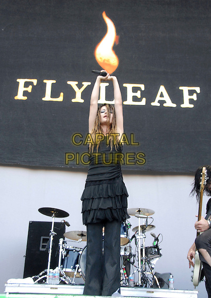 FLYLEAF.Performs with a fan from Myspace live at The Family Values Tour held at The Hyundai Pavilion in San Bernadino, California, USA,  August 19th 2006..full length band music live concert on stage black dress hands arms up.Ref: DVS.www.capitalpictures.com.sales@capitalpictures.com.©Debbie VanStory/Capital Pictures