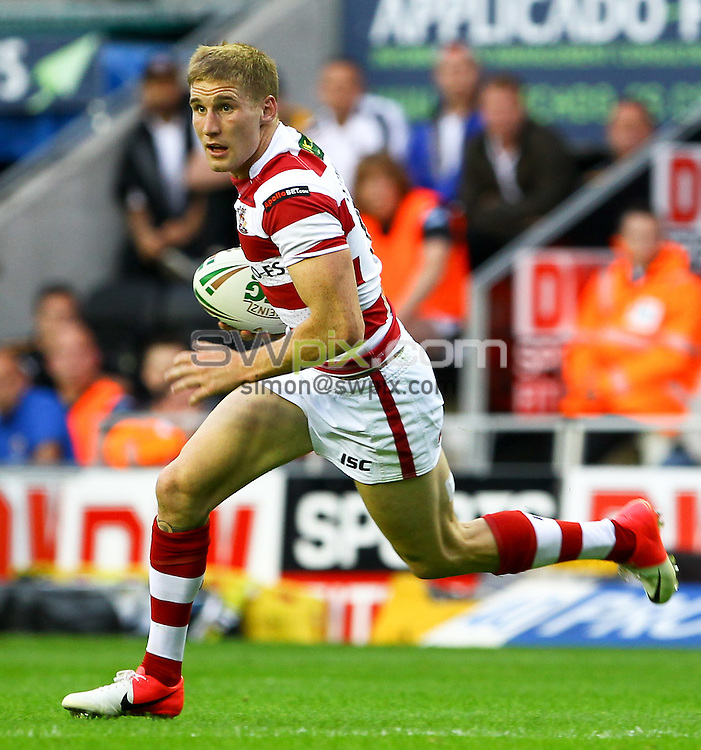 PICTURE BY ALEX WHITEHEAD/SWPIX.COM - Rugby League - Super League - Wigan Warriors v Castleford Tigers - DW Stadium, Wigan, England - 27/07/12 - Wigan's Sam Tomkins in action.