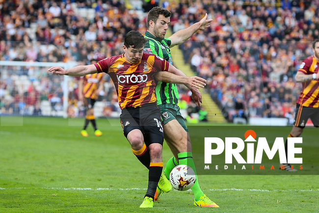 Jon Meades of AFC Wimbledon fouls Josh Cullen of Bradford City in the penalty area during the Sky Bet League 1 match between Bradford City and AFC Wimbledon at the Northern Commercial Stadium, Bradford, England on 22 April 2017. Photo by Thomas Gadd.