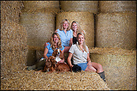 BNPS.co.uk (01202 558833)<br /> Pic: PhilYeomans/BNPS<br /> <br /> L-r Harriet (25), Carol (52), Katy (21) and Georgina (28).<br /> <br /> Far from the Madding Crowd - Land Girls...Plucky mum and her daughters running the family farm in the heart of Dorset.<br /> <br /> Widow Carol Besent is getting a bumper harvest in this year with the help of her three daughters Georgina, Harriet and Katy.<br /> <br /> Carol's husband died four years ago and rather than give up the family farm Carol and her daughters have taken the unusual step of running the 700 acre mixed arable and dairy farm themselves.