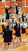 Westside Eagle Observer/MIKE ECKELS<br /> <br /> The Gravette Lions cheer team performs a triple elevator maneuver during half time of the Gravette-Prairie Grove varsity girls basketball contest at the competition gym Jan.14. The cheerleaders are a vital part of game day linking the fans to the teams