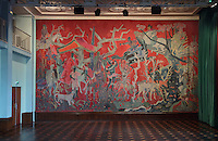 Tapestry in the Salle des Fetes, by Roger Bezombes, 1913-1994, in the Residence Lucien Paye, designed by Jean Vernon, Bruno Philippe and Albert Laprade, 1883-1978, and inaugurated 1949, in the Cite Internationale Universitaire de Paris, in the 14th arrondissement of Paris, France. Bezombes has designed huge tapestries made by Ateliers Hamot in Aubusson, with legendary characters, traditions, African animals and Madagascan flora. The parquet flooring is in ebony, bilinga and padauk. Originally the Overseas French Territories House, the building was later used to house students from Sub-Saharan African countries. Pierre Meauze sculpted the pillars at the entrance and Anna Quinquaud made the bas-reliefs on the facade. The CIUP or Cite U was founded in 1925 after the First World War by Andre Honnorat and Emile Deutsch de la Meurthe to create a place of cooperation and peace amongst students and researchers from around the world. It consists of 5,800 rooms in 40 residences, accepting another 12,000 student residents each year. Picture by Manuel Cohen. L'autorisation de reproduire cette œuvre doit etre demandee aupres de l'ADAGP/Permission to reproduce this work of art must be obtained from DACS.