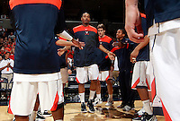 CHARLOTTESVILLE, VA- DECEMBER 6: Mike Scott #23 of the Virginia Cavaliers with teammates during the game on December 6, 2011at the John Paul Jones Arena in Charlottesville, Virginia. Virginia defeated George Mason 68-48. (Photo by Andrew Shurtleff/Getty Images) *** Local Caption *** Mike Scott