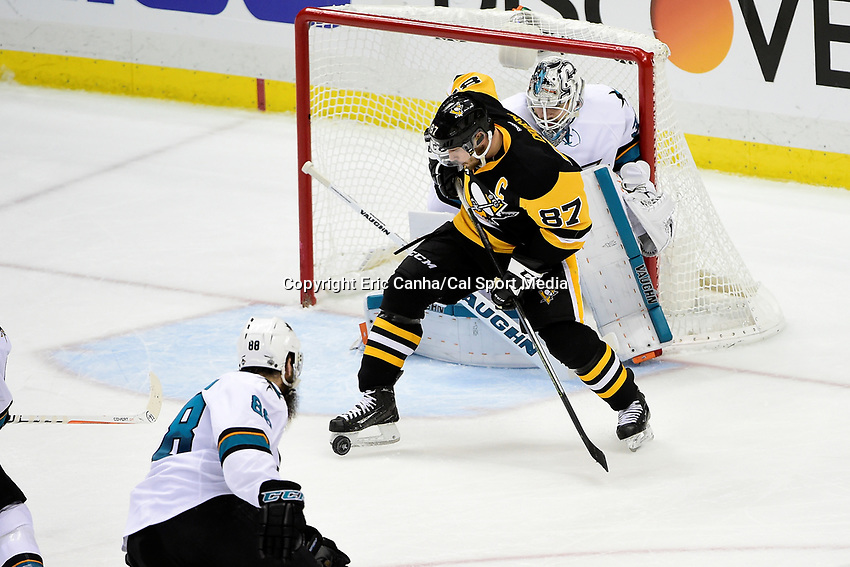 Wednesday, June 1, 2016: Pittsburgh Penguins center Sidney Crosby (87) plays the puck in front of San Jose Sharks goalie Martin Jones (31) during game 2 of the NHL Stanley Cup Finals  between the San Jose Sharks and the Pittsburgh Penguins held at the CONSOL Energy Center in Pittsburgh Pennsylvania. The Penguins beat the Sharks in overtime 2-1 and lead the best of 7 series 2-0. Eric Canha/CSM