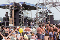 The Grateful Dead Concert at Raceway Park, Englishtown NJ on 3 September 1977. Labor Day Weekend. The Stage, Fans and Deadheads before the Marshall Tucker Band. This shot is inside the venue.