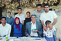 Turkey 1995.In Midin, one of the last Syriac Christian village of Tour Abdin: Hano Urek with his wife and around them sons and relatives..Turquie 1995.Au village de Midin, parmi les derniers chretiens de la region de Tour Abdin, Hano Urek avec sa femme  et a cote d'eux ses fils et des proches parents