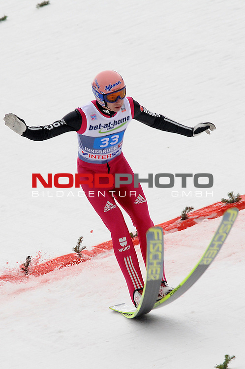 Innsbruck, Austria 04.01.2014 <br /> 2013-14 Vierschanzentournee, <br /> FIS Ski Jumping World Cup <br /> Michael Neumayer of Germany in action during the FIS Ski Jumping World Cup Vierschanzentournee on January 4, 2014 in Innsbruck, Austria.<br /> Foto &copy; nph / Pier Paolo Piciucco