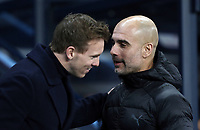 1899 Hoffenheim manager Julian Nagelsmann (left) is greeted by Manchester City manager Josep Guardiola ahead of kick-off<br /> <br /> Photographer Rich Linley/CameraSport<br /> <br /> UEFA Champions League Group F - Manchester City v TSG 1899 Hoffenheim - Wednesday 12th December 2018 - The Etihad - Manchester<br />  <br /> World Copyright © 2018 CameraSport. All rights reserved. 43 Linden Ave. Countesthorpe. Leicester. England. LE8 5PG - Tel: +44 (0) 116 277 4147 - admin@camerasport.com - www.camerasport.com