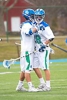 Salve's Zach Makoske,'18, right, celebrates a goal with teammate Matt Heeter,'18, during the Men's Lacrosse game action against Roger Williams at Gaudet Field in Middletown.