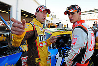 Feb 07, 2009; Daytona Beach, FL, USA; NASCAR Sprint Cup Series driver Kyle Busch (left) talks with teammate Joey Logano during practice for the Daytona 500 at Daytona International Speedway. Mandatory Credit: Mark J. Rebilas-