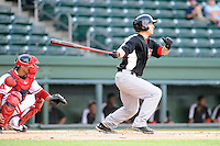 Catcher David Lyon (36) of the Hickory Crawdads bats in a game against the Greenville Drive on Friday, June 7, 2013, at Fluor Field at the West End in Greenville, South Carolina. The catcher is the Drive's Jayson Hernandez. Greenville won the resumption of this May 22 suspended game, 17-8. (Tom Priddy/Four Seam Images)