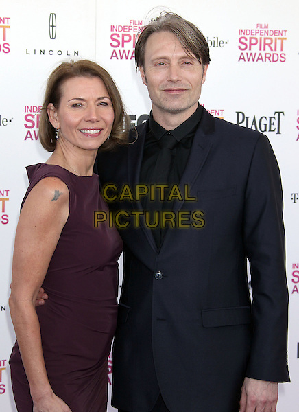Anne & Mads Mikkelsen.2013 Film Independent Spirit Awards - Arrivals Held At Santa Monica Beach, Santa Monica, California, USA,.23rd February 2013..indy indie indies indys half length suit married husband wife dress black brown maroon.CAP/ADM/RE.©Russ Elliot/AdMedia/Capital Pictures