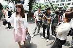 """July 2, 2010 - Tokyo, Japan - Rina Bovrisse's, former senior Retail manager at Prada Japan, speaks to reporters prior the 2nd Hearing of Prada Japan Case at Tokyo District Court, Japan, on July 2, 2010. Rina Bovrisse, joined by two other """"former Prada  Japan employees, is suing the Italian fashion designer after she was placed on involuntary leave last November. The 36-year-old Japanese national had claimed she was asked to 'eliminate' around 15 managerial staff who was categorized as """"aged, ugly, fat, bad body shape, bad teeth, disgusting, and not cute."""""""