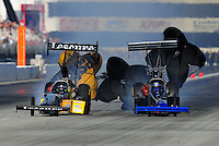 Nov. 11, 2011; Pomona, CA, USA; NHRA top fuel dragster driver Mike Ashley (left) nearly collides with Pat Dakin during qualifying at the Auto Club Finals at Auto Club Raceway at Pomona. Mandatory Credit: Mark J. Rebilas-.
