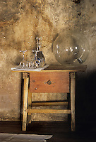 Deatil of a contemporary glass lamp on a rustic wooden bedside table